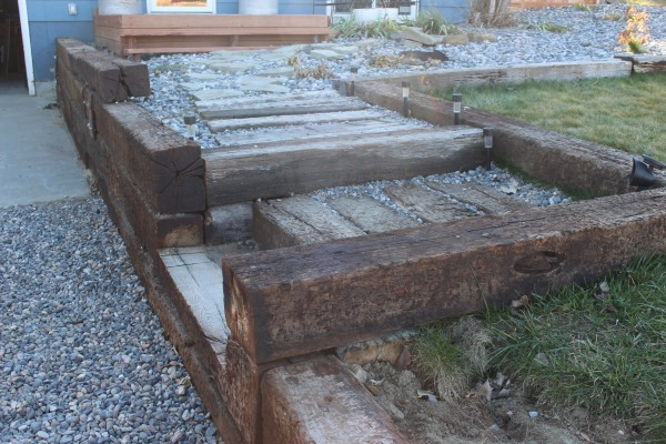 the happy crazy hosue railroad tie retaining wall and stairs
